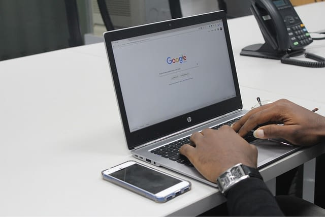 Man Searching Google on his Laptop