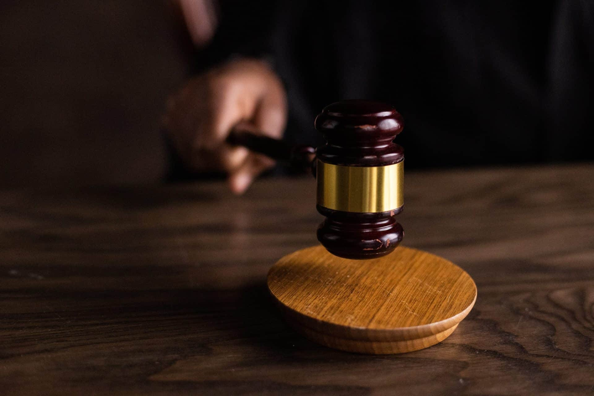 close up of a gavel being used in court
