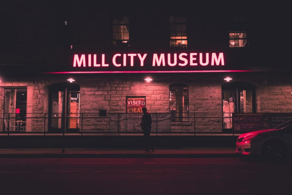 Mill City Museum sign lit up in red at night