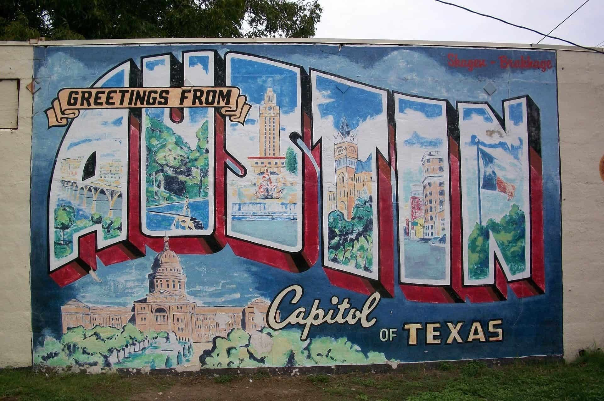 """Mural that reads """"greetings from Austin Capitol of Texas"""""""