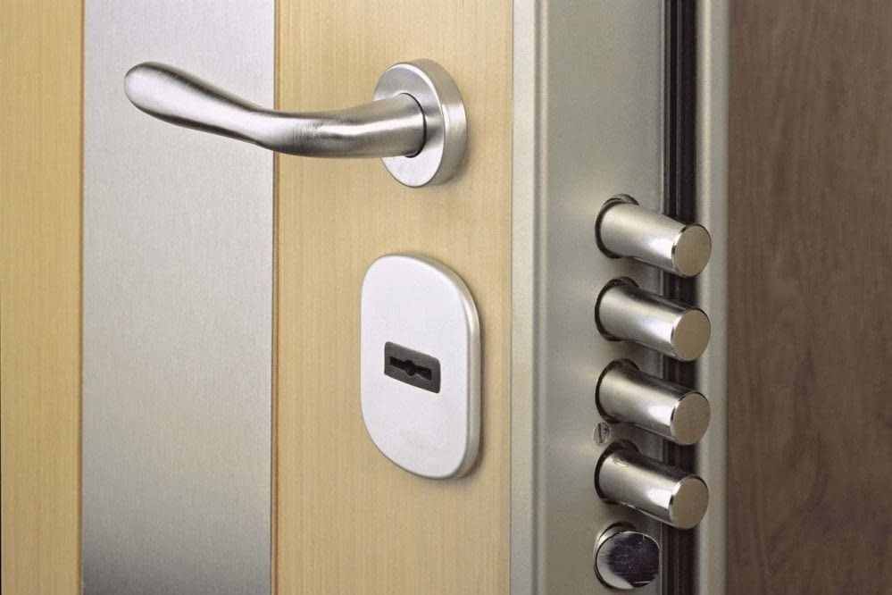 Close up of a high security lock with 4 deadbolts
