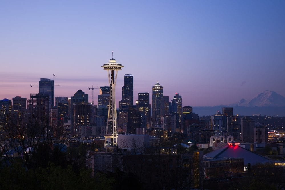 Seattle skyline at dusk with the Space Needle most lit up