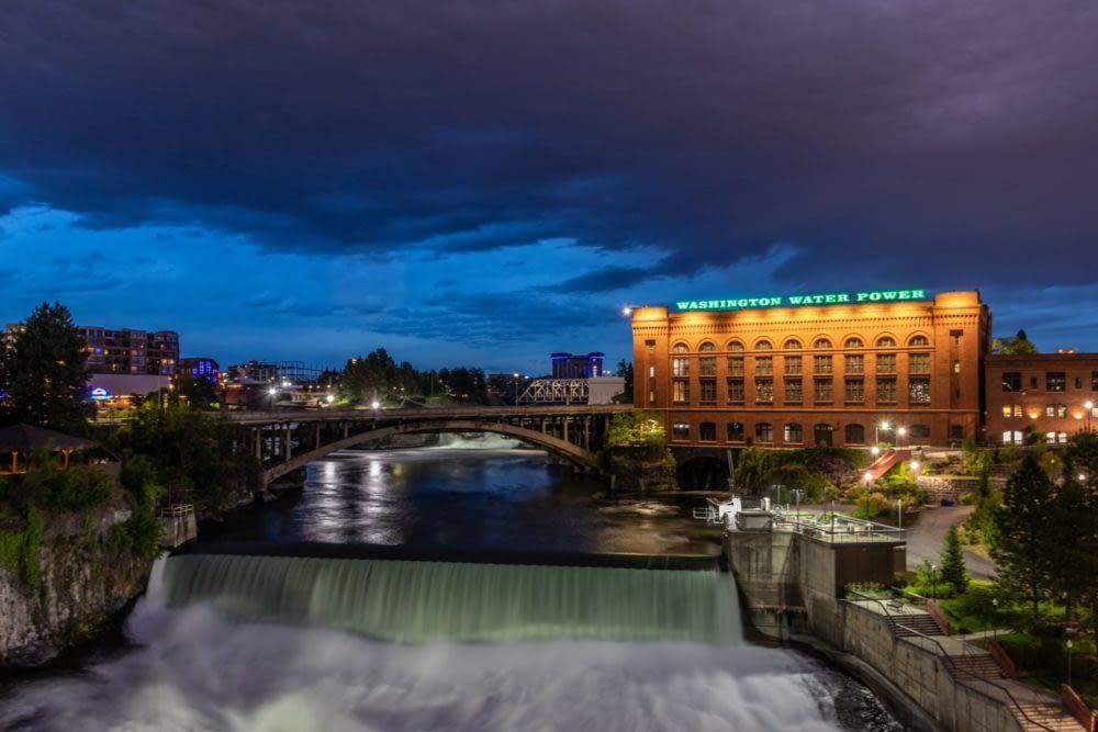 Spokane Washington Water Power building and small waterfall at night